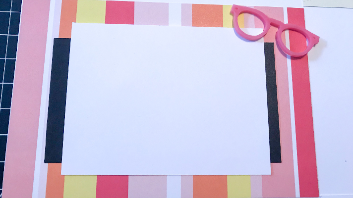 Adding acrylic shapes to the summer scrapbook page