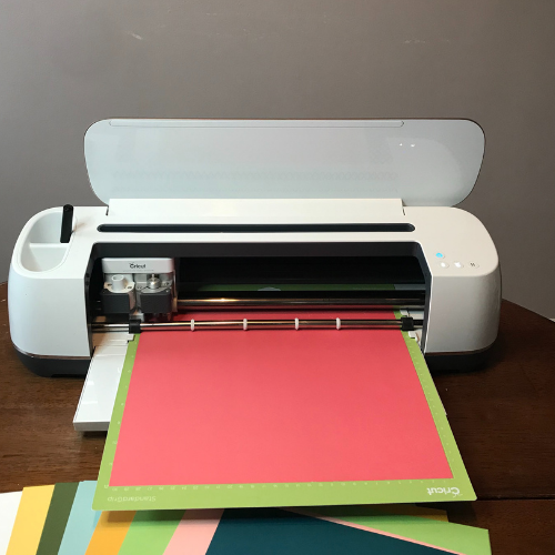 Cricut Maker cutting the card stock for the Cricut Spring Scrapbook pages