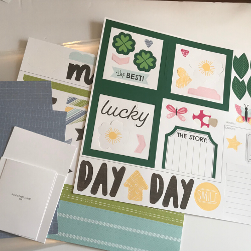 the scrapbook kit comes with all the paper, stickers, and embellishments
