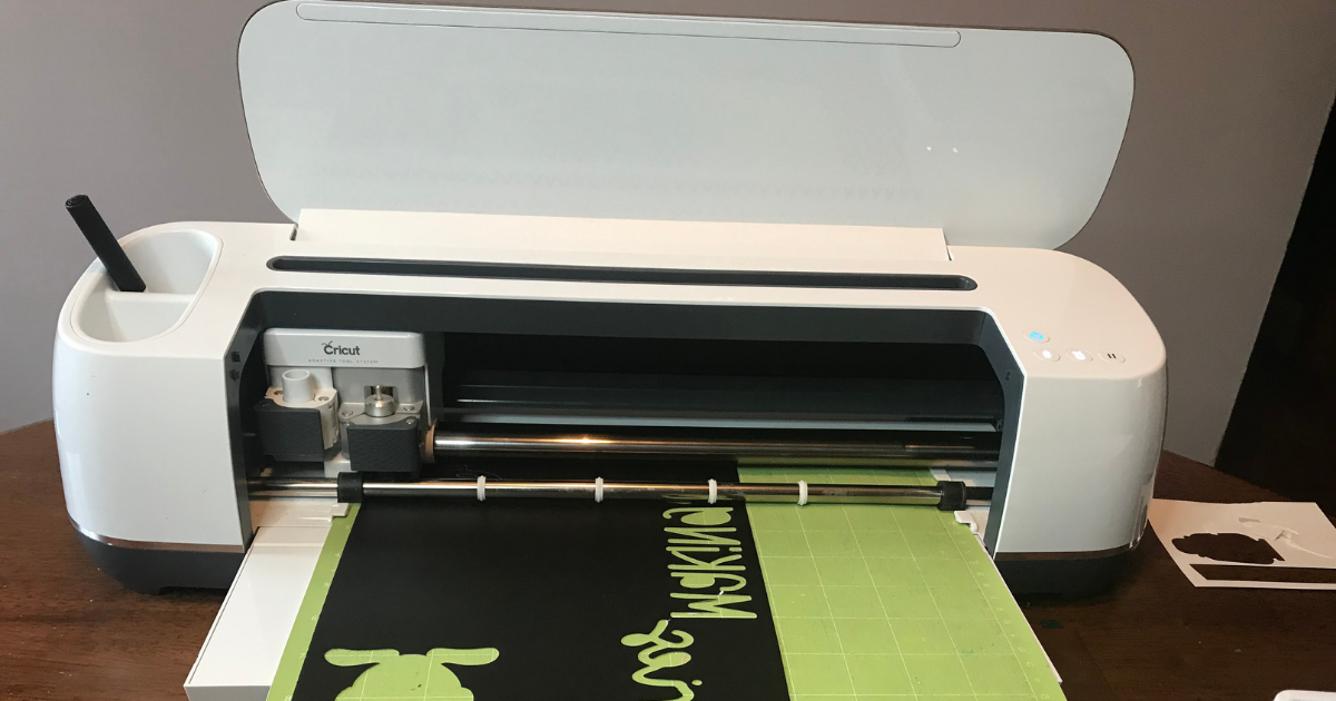 The Cricut Maker cutting the picnic scrapbook layout design in card stock