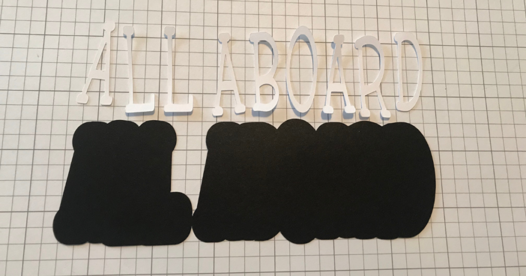 Cricut cut card stock with text and offset shadow from Design Space