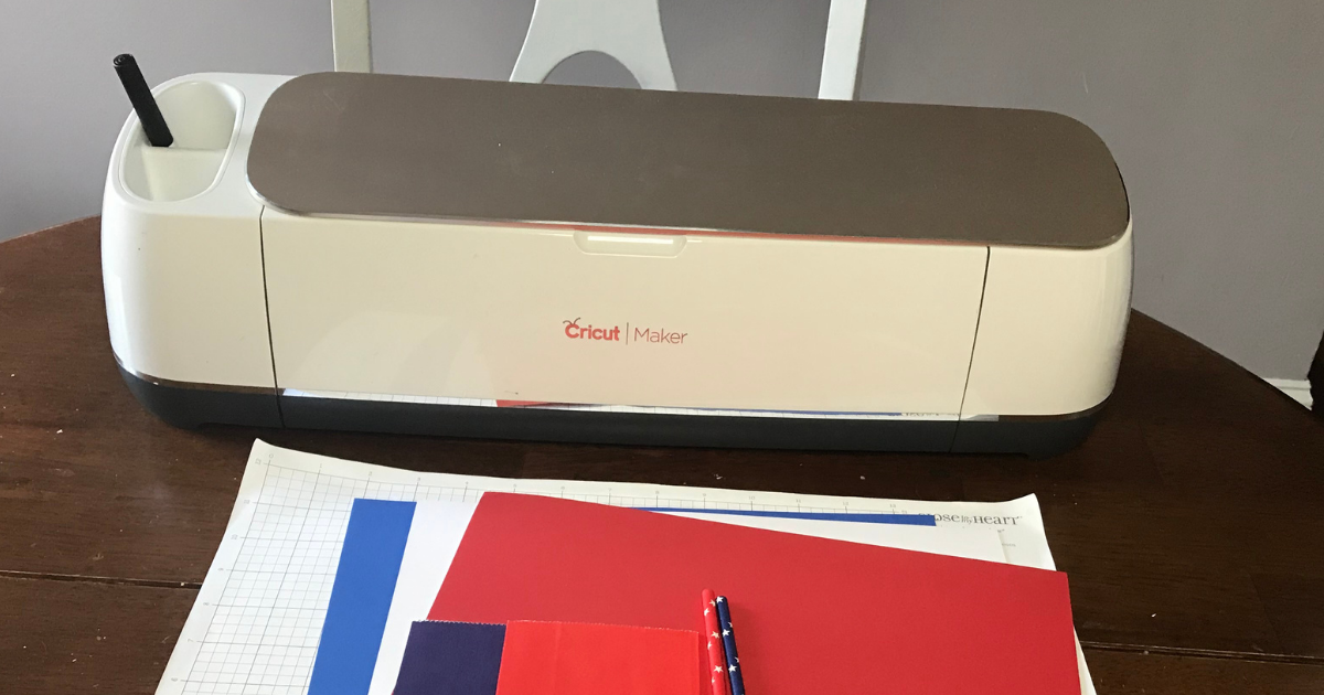Supplies for 4th of July Cricut Craft idea with Cricut machine, card stock, and paper straws