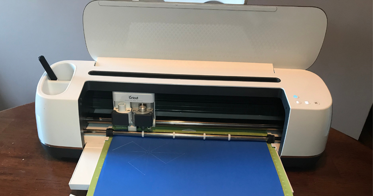 Cricut maker cutting the card stock for 4th of July Cricut project