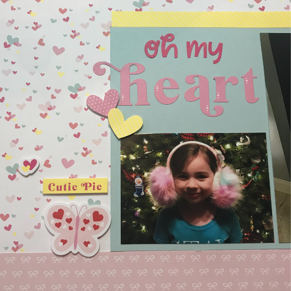 Adding stickers to the scrapbook page to decorate it