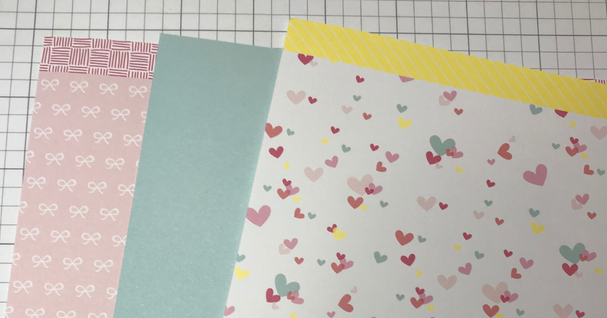 CTMH Scrapbook paper is the third step in creating a perfect page